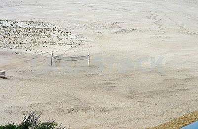 Volleyball net on the deserted beach of Praia de Odeceixe