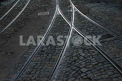 Tram rails and hatches on a cobbled road