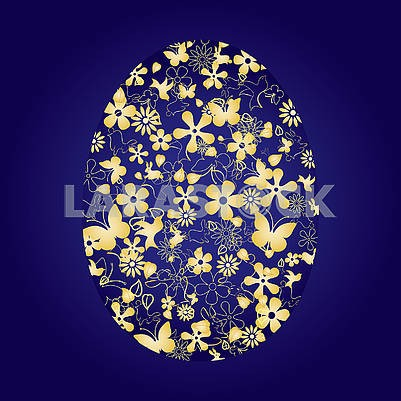 Decorated Easter egg on blue background