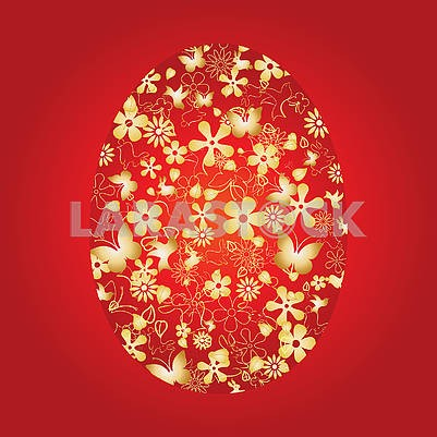 Golden Decorated Easter egg on red background