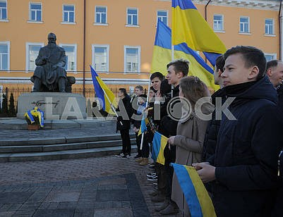 Laying flowers at the monument to Mikhail Hrushevsky