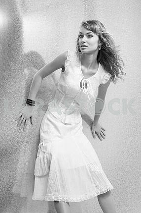 Beautiful Young Woman with bright background. In a white dress