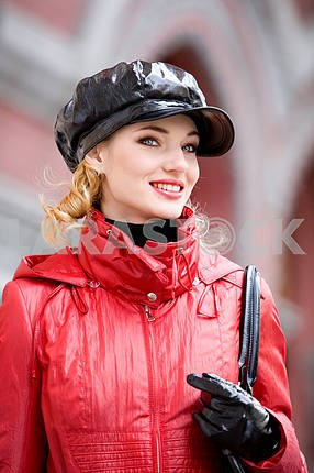 Portrait of smiling girls in red coats and hat