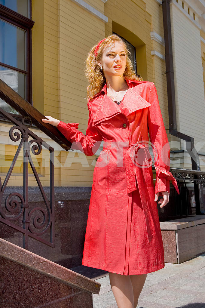 Beautiful Young Woman in red clothes. Near the stairs — Image 8021