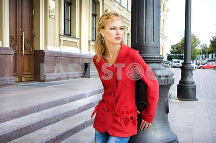 Beautiful Young Woman in red clothes. Against the backdrop of  b