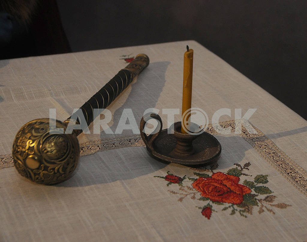 Hetman mace and candle on the table — Image 80503
