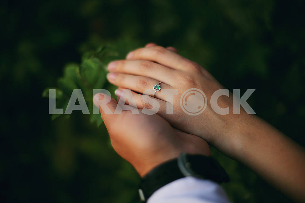 Hands of a young couple with a ring. love, couple, relationship and holidays concept - close up of man giving diamond ring to woman — Image 80615