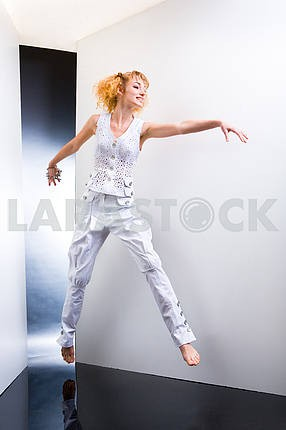 Young Woman jumps and fun in the studio