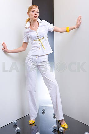 Beautiful Young Woman in a white dress. In all growth. In the st