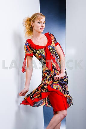 Beautiful Young woman in red dress.  In all growth. On white bac