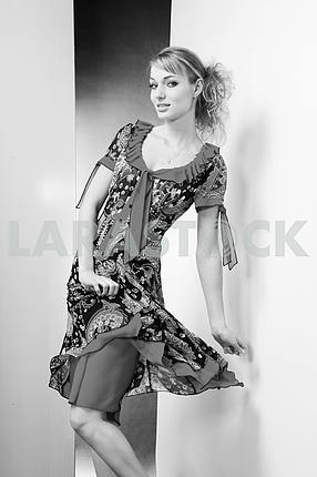 Beautiful Young woman in dress.  In all growth. On white backgro