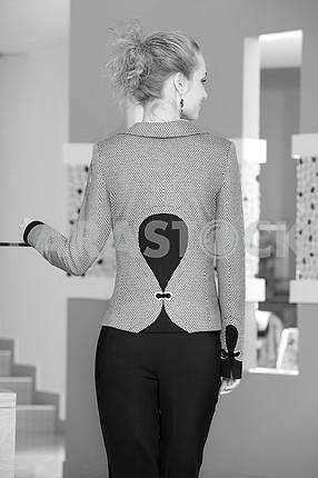 Beautiful young woman in suit. Back