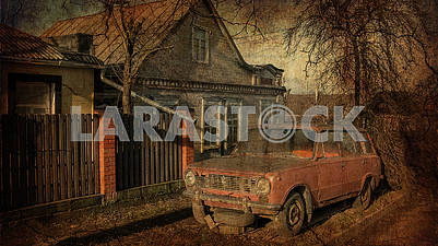 Old car stands on the street near the house