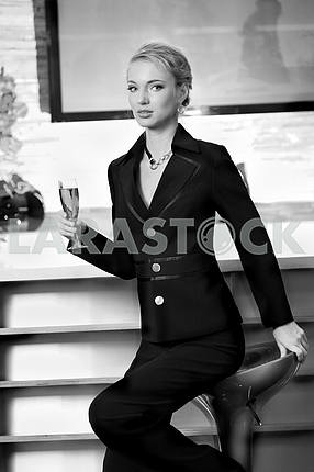 Beautiful woman drinking wine at bar