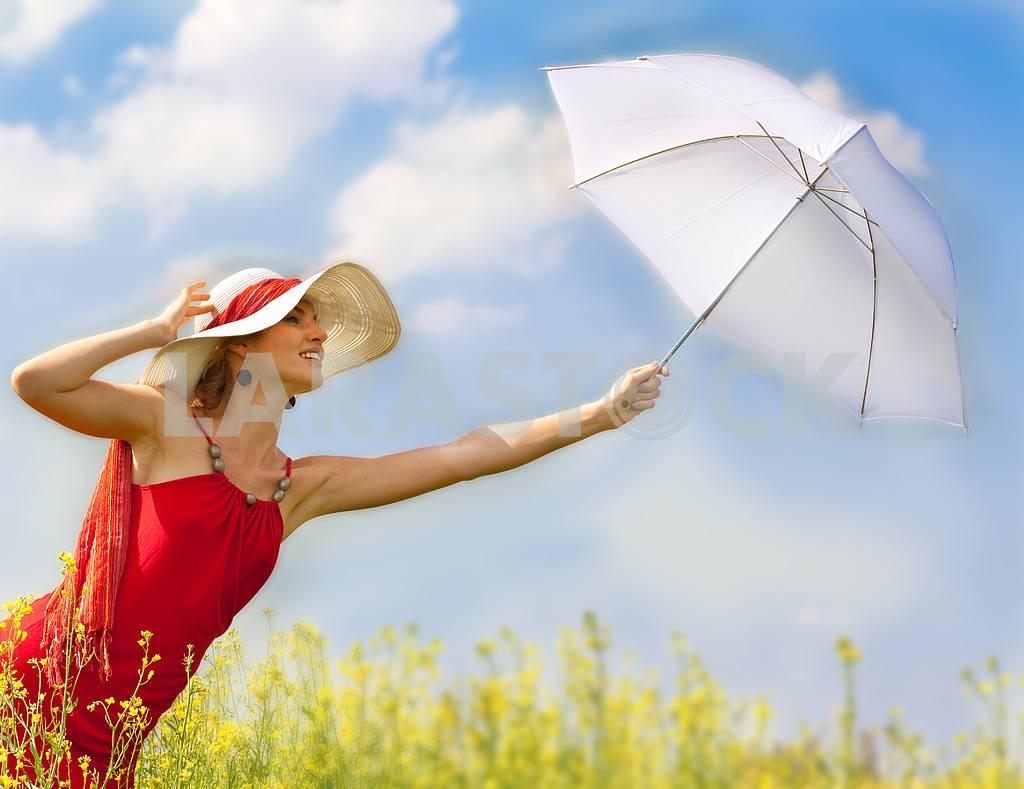 Beautiful asian girl under blue sky with umbrella in field. — Image 8207