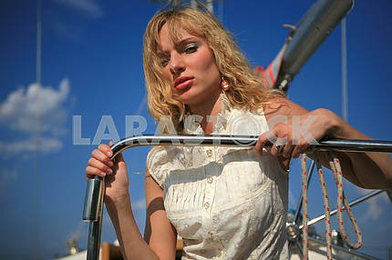 Young woman on sailboat desk