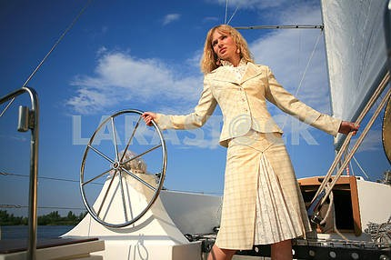 Young woman on sailboat desk look