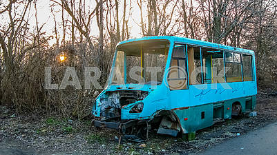 Skeleton of a body of a passenger minibus near the road