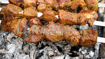 BBQ  meat on barbecue. Grilled kebab cooking on metal skewer.
