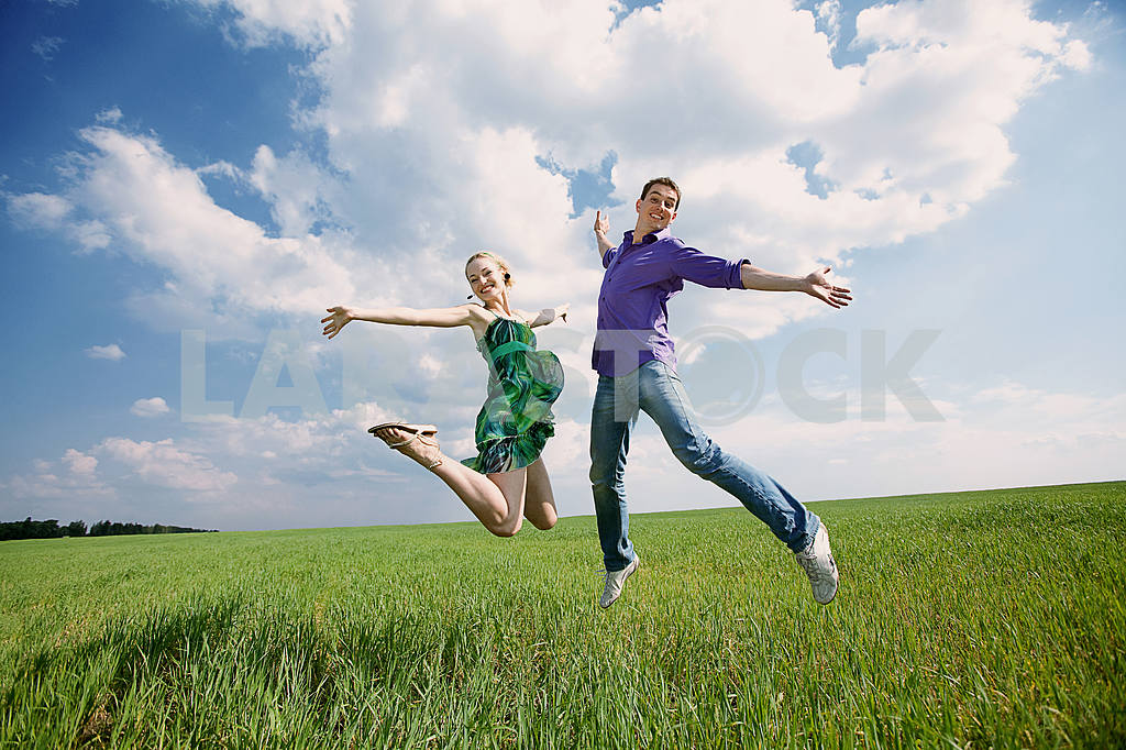 Happy people is jumping in field — Image 8299