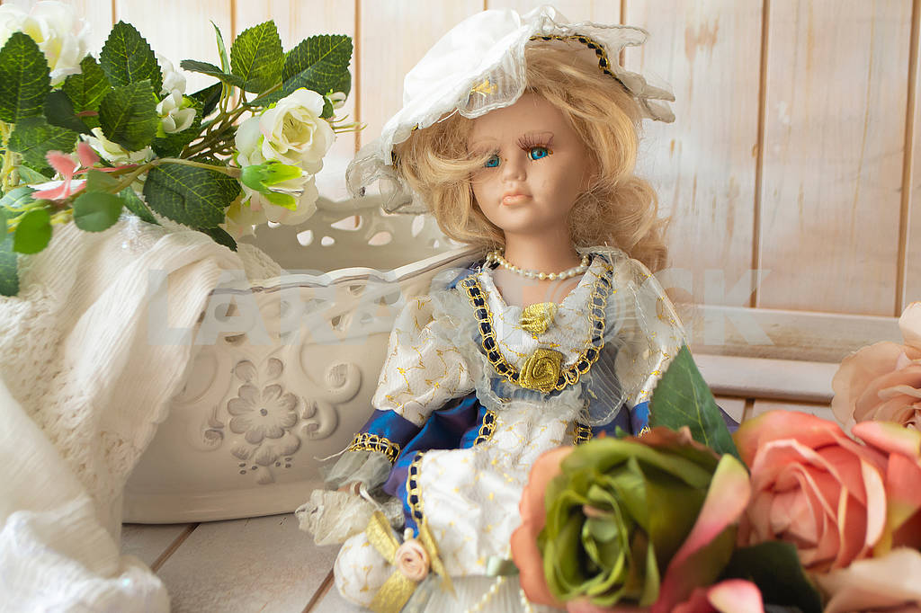 Still life in vintage style with a doll and pastel roses on a shabby background of old wooden planks — Image 82996