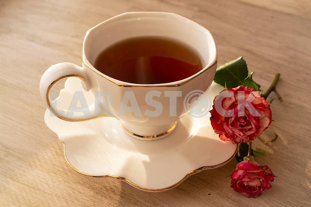 Healthy tea in white classic cup with roses, vintage image — Image 83032