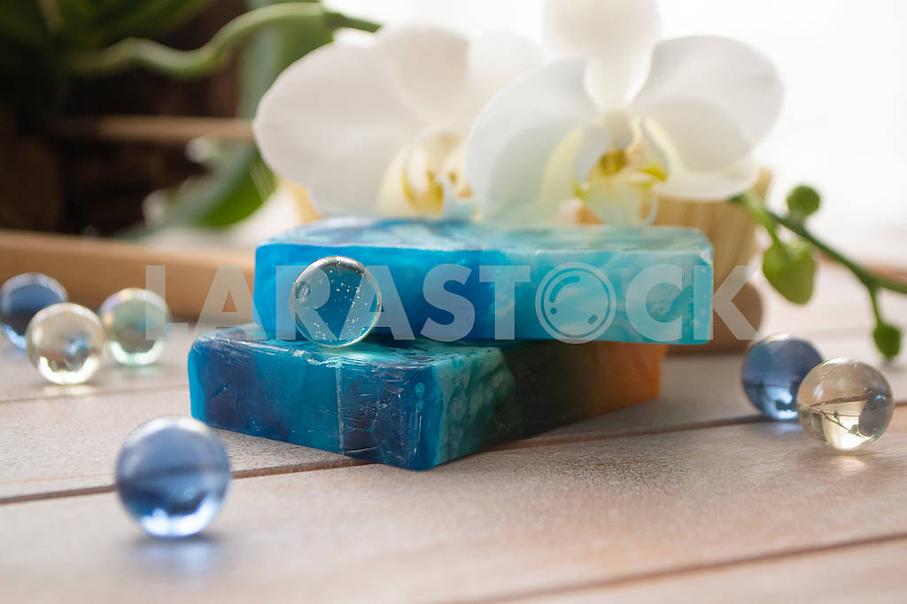 Sea salt, natural soap and orchid flower on wooden background. Aroma spa set — Image 83079