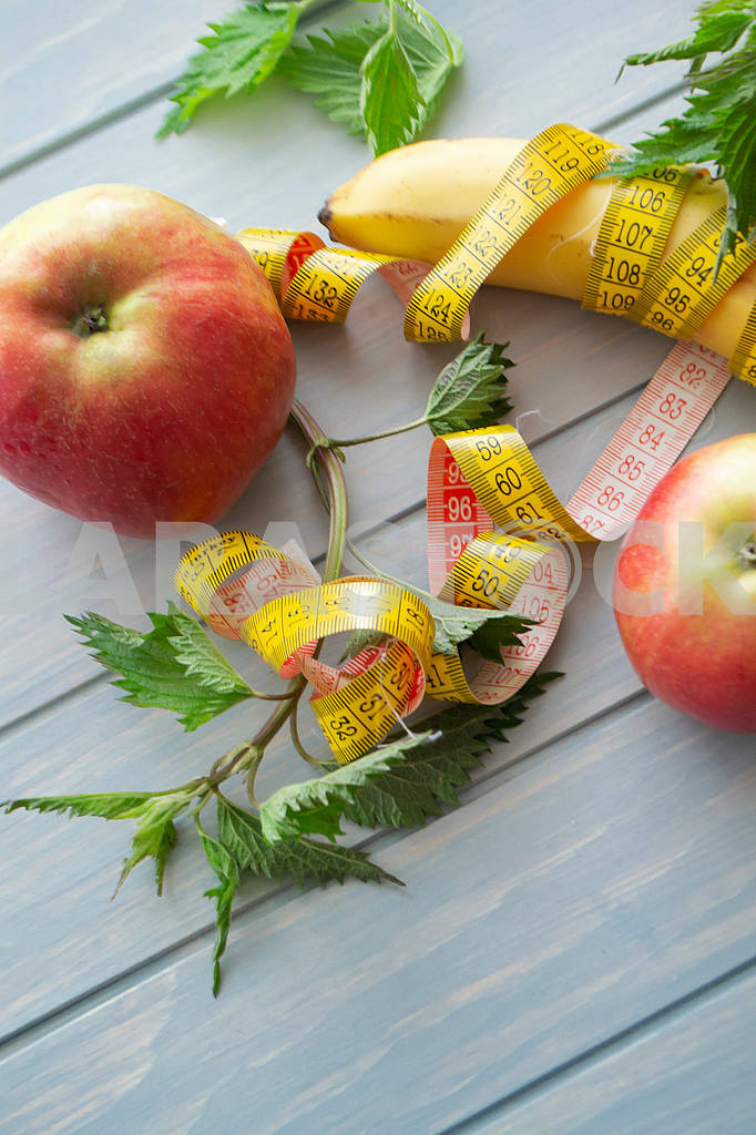 Fruits and vegetables, organic nettle, tape measure on blue wooden background. Concept of proper nutrition. — Image 83144