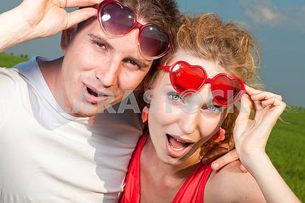 Young love Couple stares took off his glasses under blue sky