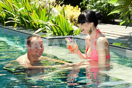 Young loving couple in pool