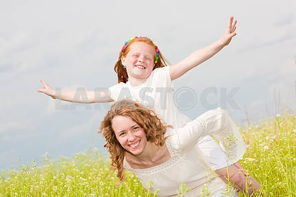 Mom and Daughter Having Fun in the field