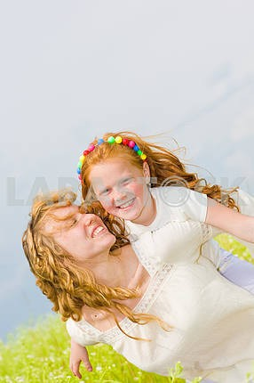 Mom and Daughter Having Fun in field