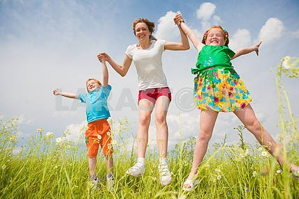 Mother with children Having Fun in the field