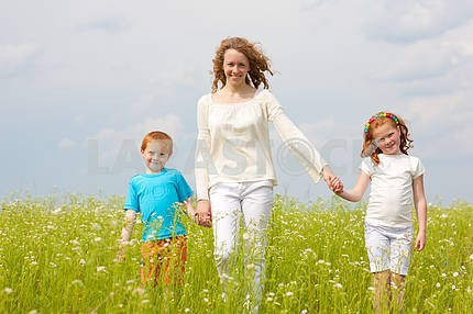 A mother with children goes on the field