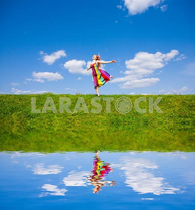 Happy girl fleeing on a meadow.