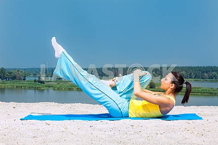 Sporting a young girl has pilates