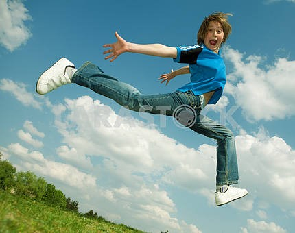 Happy boy run against beautiful sky