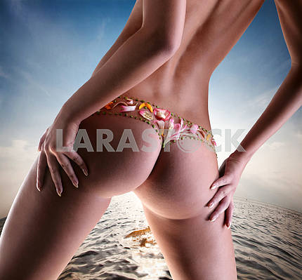 Girl with a flower on buttocks