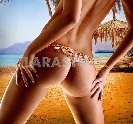 Girl with a flower underwear background of the beach