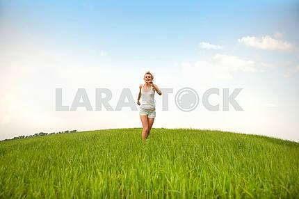 Happy young women running in field