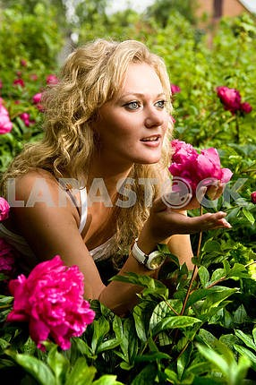 Lovely young woman in garden