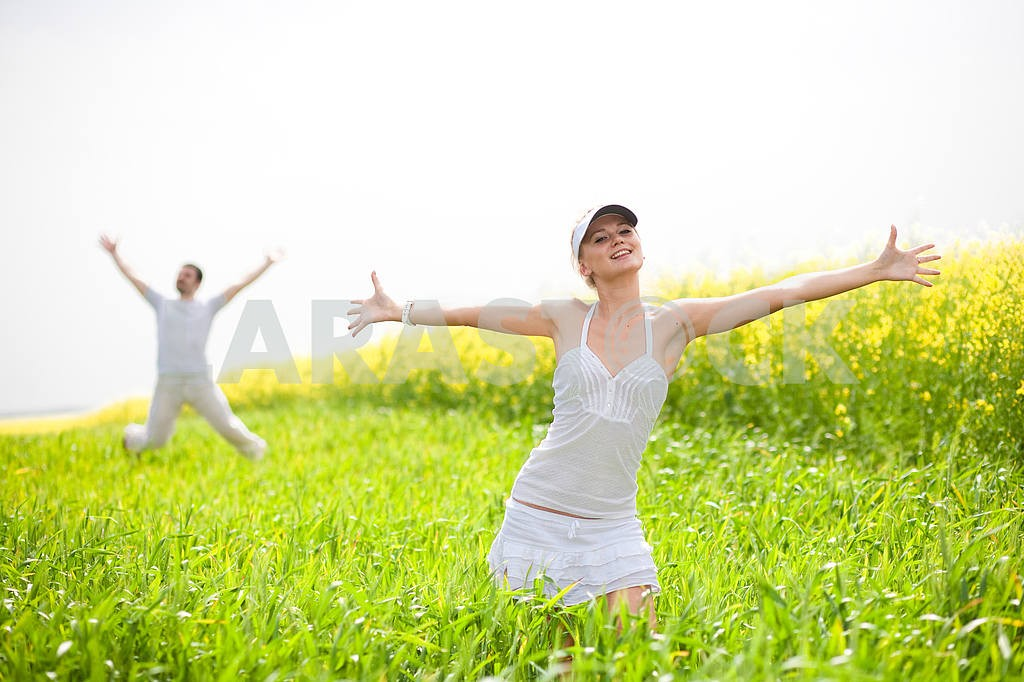 Happy people is jumping in field — Image 9317