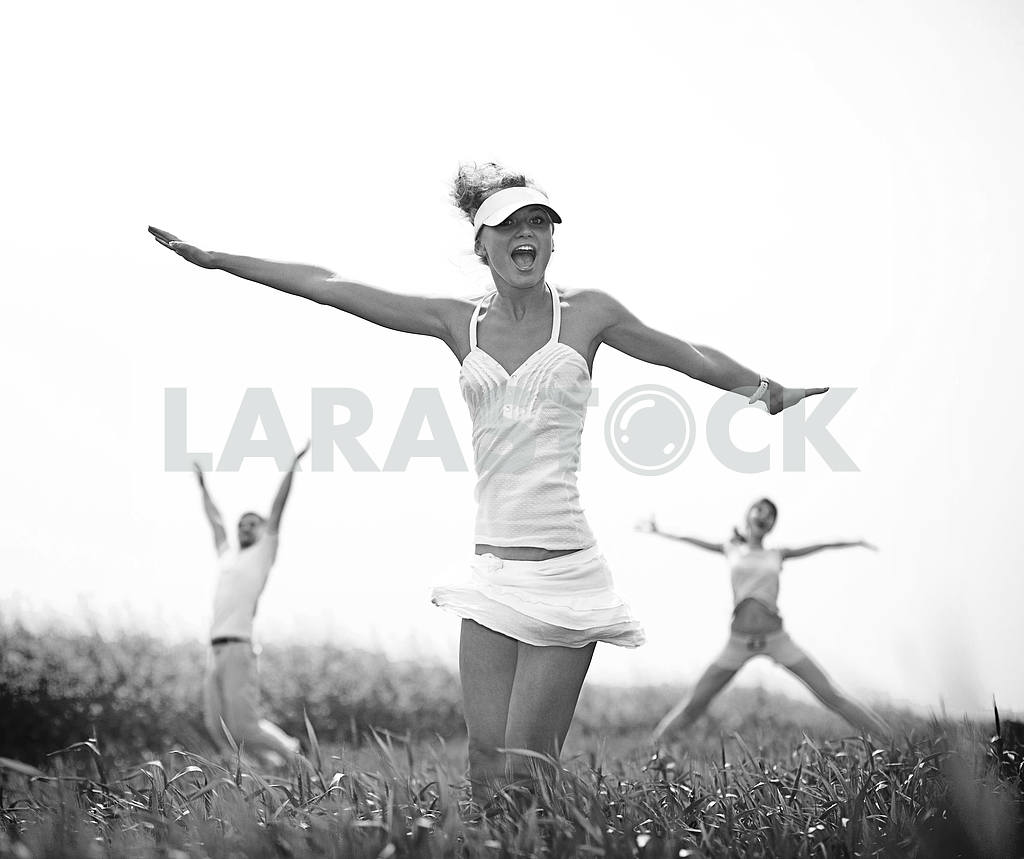 Happy people jumping field — Image 9325