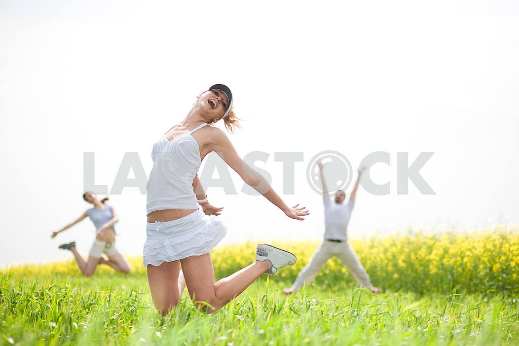 Happy people is jumping in field — Image 9328