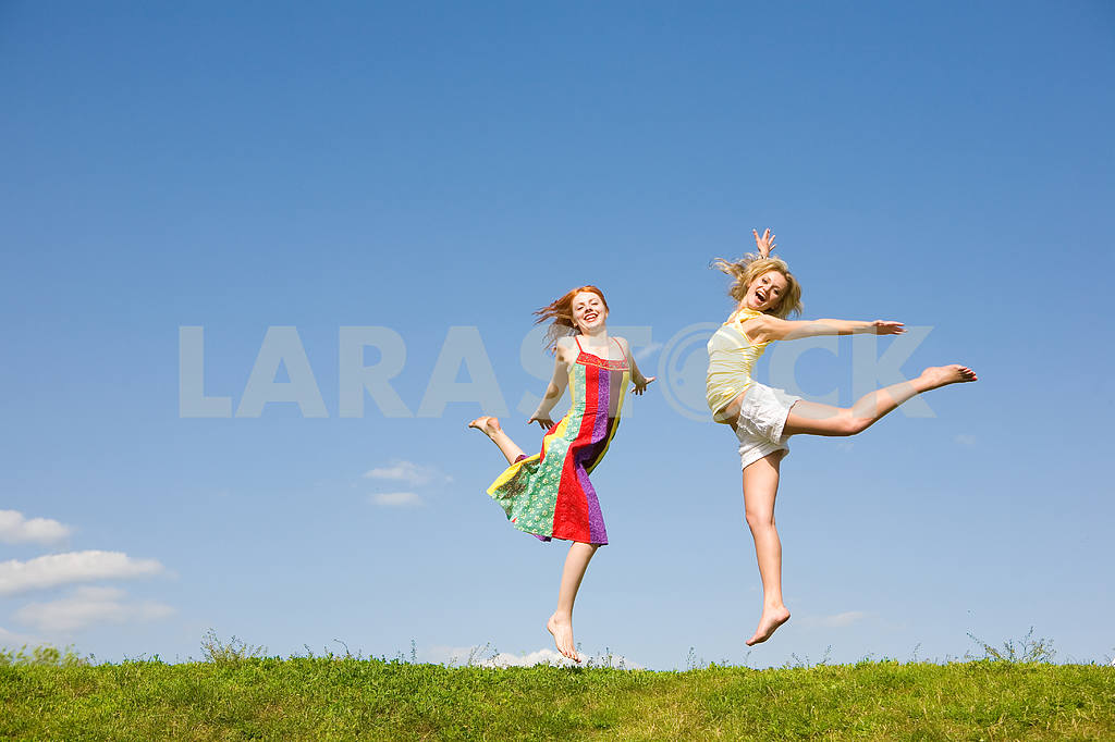 Two happy girls jumping — Image 9374