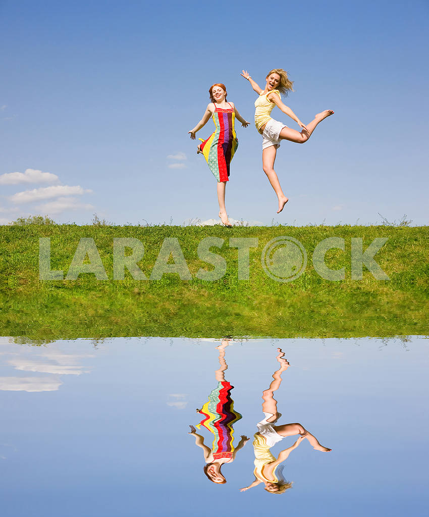 Two happy girls jumping — Image 9375