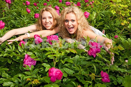 two young womans relaxing on a garden