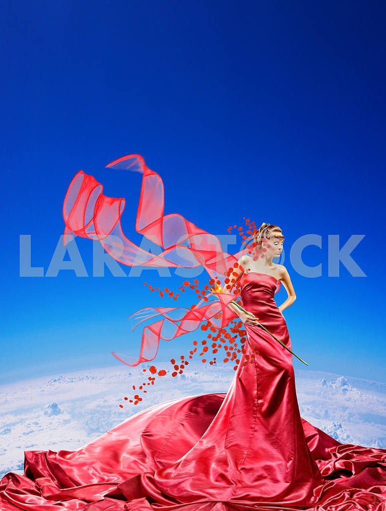 Fabulous girl in a red dress against a blue sky — Image 9486