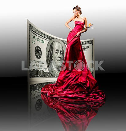 Beautiful girl in red dress, money. 100 american dollars