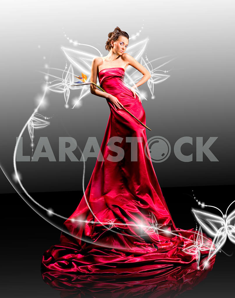 Beautiful girl in red dress against fantasy butterfly luminous — Image 9509